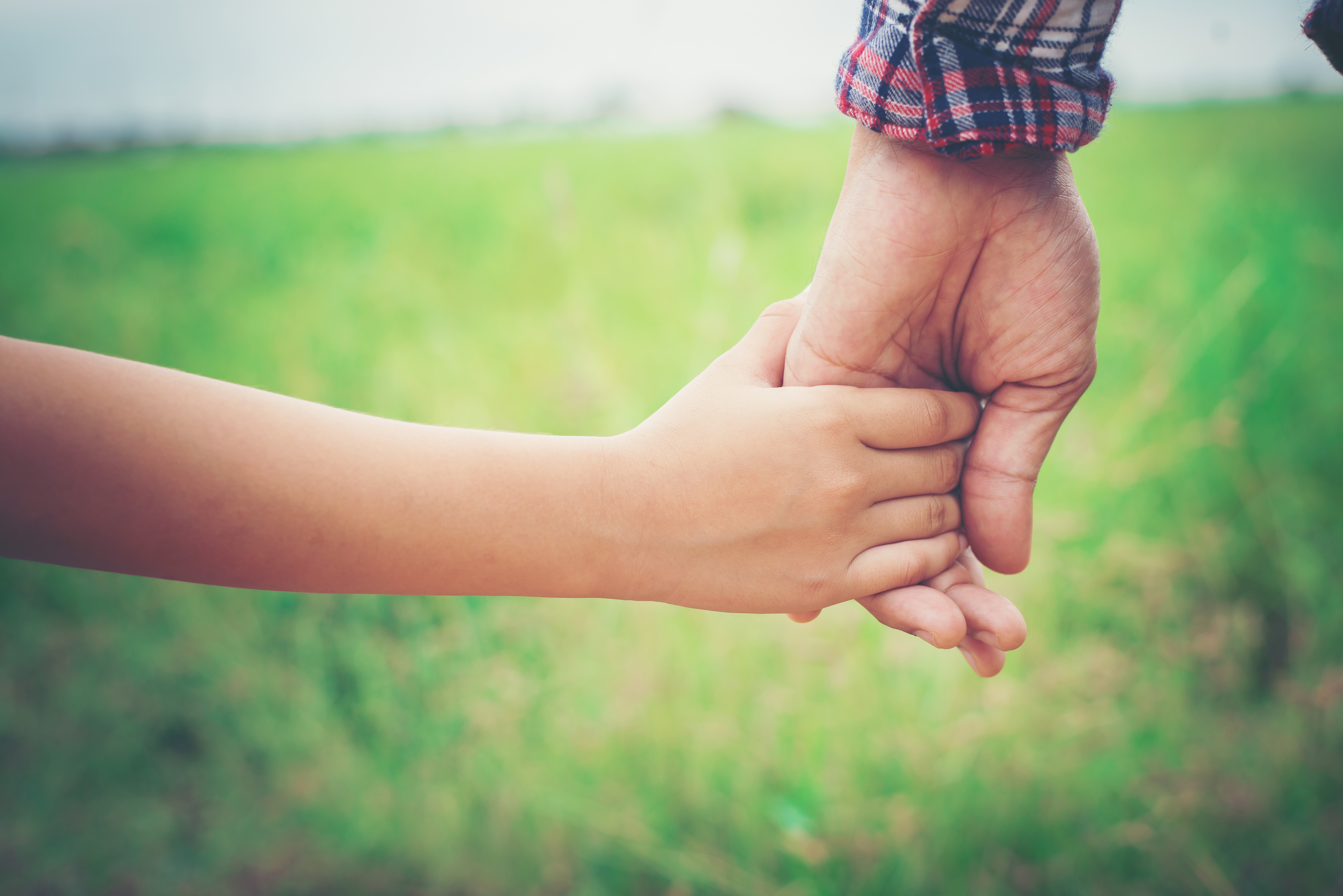 close-up-father-holding-his-daughter-hand-so-sweet-family-ti